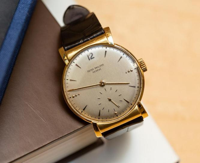 The antique Patek Philippe features a simple dial.