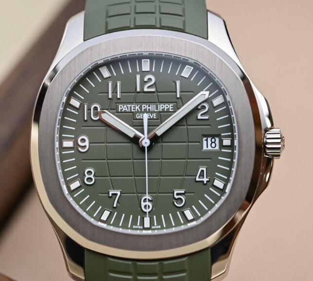 The Arabic numerals hour markers are striking on the khaki green dial.